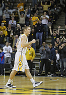 February 2 2011: Iowa Hawkeyes guard Matt Gatens (5) pumps his fist at the end of the first half of an NCAA college basketball game at Carver-Hawkeye Arena in Iowa City, Iowa on February 2, 2011. Iowa defeated Michigan State 72-52.