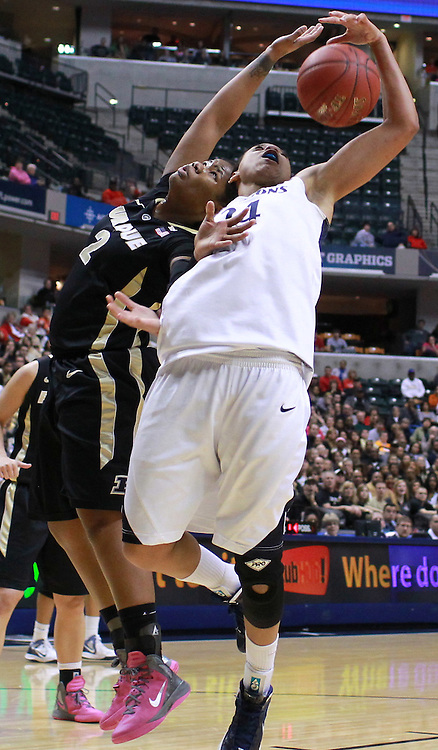 March 03, 2012; Indianapolis, IN, USA; Purdue Boilermakers guard Antionette Howard (2) and Penn State Lady Lions forward Mia Nickson (24) battle for a rebound during the semifinals of the 2012 Big Ten Tournament at Bankers Life Fieldhouse. Purdue defeated Penn State 68-66. Mandatory credit: Michael Hickey-US PRESSWIRE