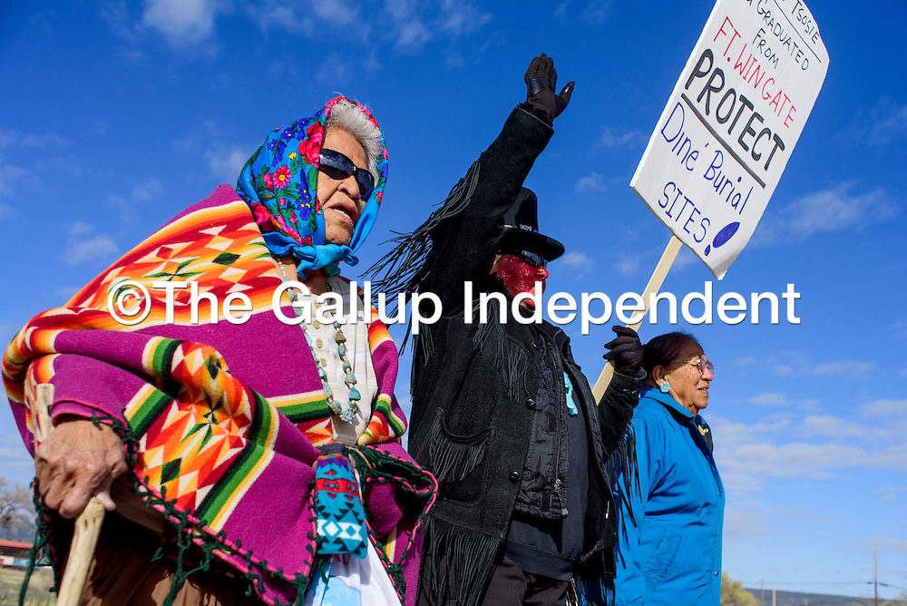 Marie Kirlie, left, Nicole Walker and Liz Whitman march to the Navajo Nation Council Chambers in Window Rock Monday. The women were part of a protest that sought the declaration of Fort Wingate as a sacred Navajo Site.