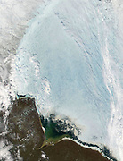 satellite view over Hudson Bay, Canada. Large ice flow is shown over the bay.