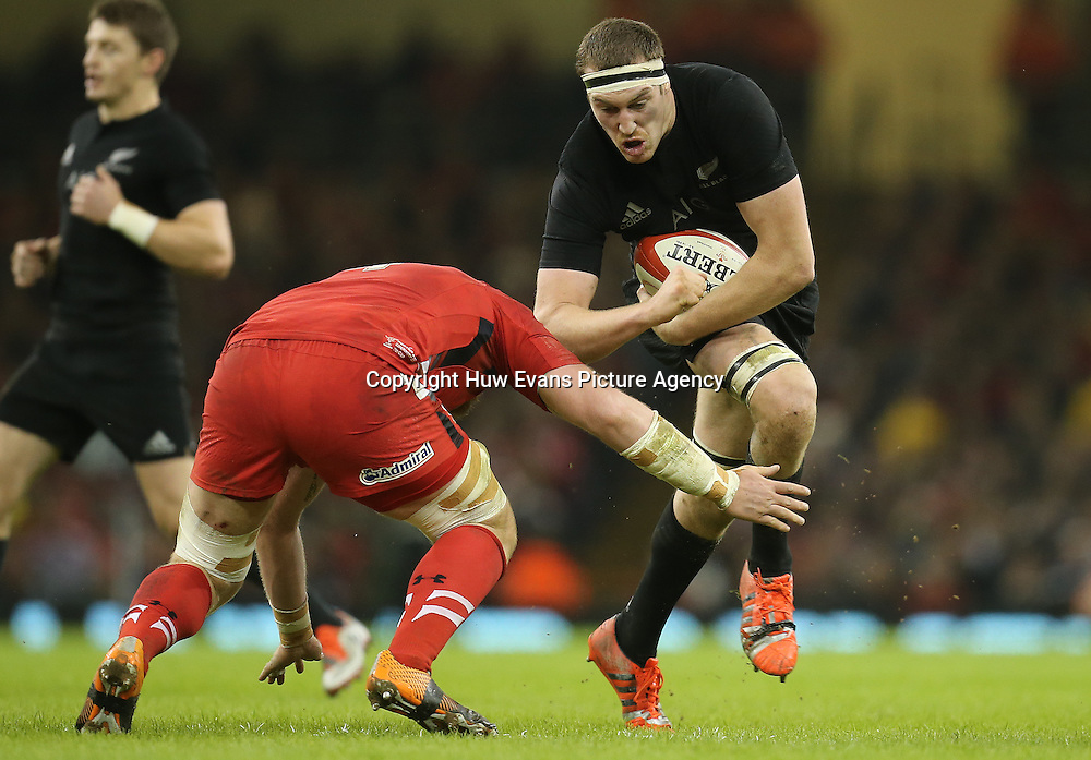 22.11.14 -  Wales v New Zealand, Dove Men Series 2014, Cardiff - <br /> Brodie Retallick of New Zealand is tackled by Jake Ball of Wales <br /> &copy; Huw Evans Agency, Cardiff
