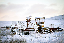 © Licensed to London News Pictures. 25/11/2017. Gearstones UK. Snow covered farm machinery on Newby Head pass in Gearstones this morning after a night of snow fall in the Yorkshire Dales. Photo credit: Andrew McCaren/LNP