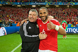 LILLE, FRANCE - Friday, July 1, 2016: Wales' assistant manager Osian Roberts and captain Ashley Williams celebrate after a 3-1 victory over Belgium and reaching the Semi-Final during the UEFA Euro 2016 Championship Quarter-Final match at the Stade Pierre Mauroy. (Pic by David Rawcliffe/Propaganda)