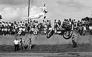 Motorcycle Daredevil Bob Pleso died after he came up short attempting a ramp to ground jump over 30 cars on August 4, 1974. As Pleso came to speed and left the launch ramp the wind shifted, depriving him of airborne speed. His rear motorcycle tire dropped prematurely coming down on a car. Pleso flipped violently through the air and hit the asphalt, skidding several hundred feet to a stop. He died at a local hospital several hours later.