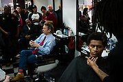 J.T. Kramer gets his hair cut as Republican U.S. presidential candidate Rand Paul holds a campaign event at Platinum Kutz barbershop in Des Moines, Iowa on January 18, 2016.