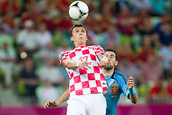 Mario Mandzukic of Croatia vs Sergio Busquets of Spain during the UEFA EURO 2012 group C match between  Croatia and Spain at PGE Arena Gdansk on June 18, 2012 in Gdansk / Danzig, Poland. (Photo by Vid Ponikvar / Sportida.com)