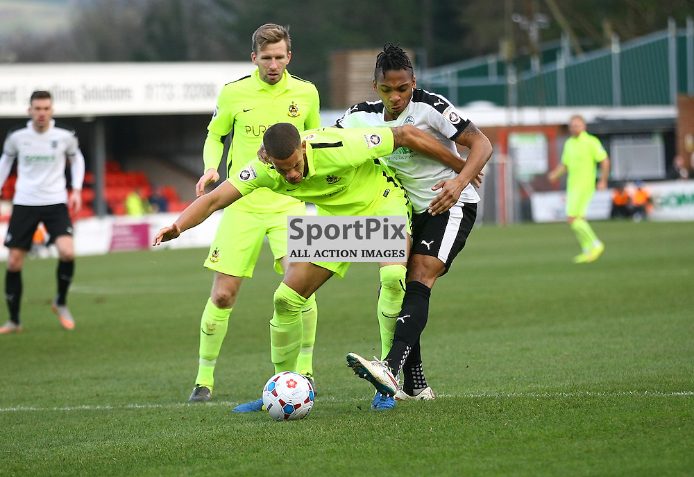 Southports Josh Thompson holds Dover's defender Aswad Thomas (21) away from the ball. Dover Athletic against Southport FC in the FA Trophy. 16 January 2016. (c) Matt Bristow | SportPix.org.uk