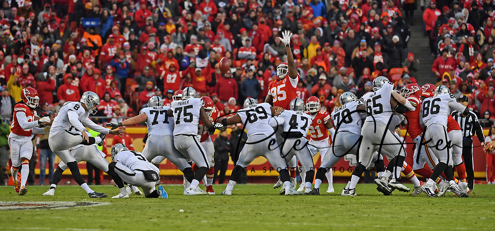 Kicker Daniel Carlson #8 of the Oakland Raiders kicks a field goal against the Kansas City Chiefs during the first half at Arrowhead Stadium in Kansas City, Missouri.