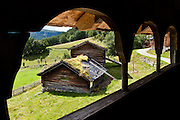 Turf roof repair viewed from inside looking out. Visit the farm museum of Rygnestadtunet (at Nordigard, in Nørdre Rygnestad, near Valle, Setesdal, Aust-Agder, Norway) to admire a unique 1590 three-story storehouse, a farmhouse with open-hearth room dating from before the Black Death (1349-50), and 15th century painted textiles.