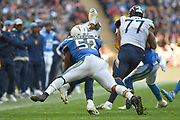 Los Angeles Chargera linebacker Denzel Perryman (52) flies in to a tackle during the International Series match between Tennessee Titans and Los Angeles Chargers at Wembley Stadium, London, England on 21 October 2018.