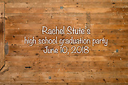 """Family, friends and guests are pictured in a """"help-your-self"""" photo booth set up inside a barn during a high-school graduation party for Rachel Stute at her dad's farm in East Troy, Wis., on June 10, 2018. (Photo by Jeff Miller - www.jeffmillerphotography.com)"""