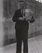 Tipperary captain John Maher with the McCarthy Cup in 1945.
