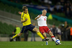 DUBLIN, REPUBLIC OF IRELAND - Wednesday, May 25, 2011: Wales' David Cotterill in action against Scotland's Christophe Berra during the Carling Nations Cup match at the Aviva Stadium (Lansdowne Road). (Photo by David Rawcliffe/Propaganda)