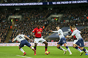 Manchester United Midfielder Paul Pogba battles with Harry Winks midfielder of Tottenham Hotspur (8) and Erik Lamela midfielder of Tottenham Hotspur (11) during the Premier League match between Tottenham Hotspur and Manchester United at Wembley Stadium, London, England on 13 January 2019.