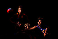 A streak of light hits Ben McEvoy of the Hawks who competes for the ball against Will Minson of the Bulldogs (R) during the round three AFL match between the Hawthorn Hawks and the Western Bulldogs at Aurora Stadium on April 19, 2015 in Launceston, Australia. (Copyright Michael Dodge/Getty Images)