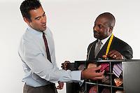 Man selecting necktie