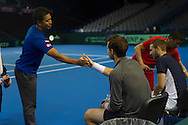 Britain's Andy Murray pictured being welcomed by a Japanese coach after arriving for the Davis Cup Practise Day at Birmingham Indoor Arena, Birmingham<br /> Picture by Anthony Stanley/Focus Images Ltd 07833 396363<br /> 03/03/2016