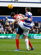Picture by David Horn/Focus Images Ltd +44 7545 970036<br /> 07/12/2013<br /> Richard Dunne of Queens Park Rangers (right) and Scott Dann of Blackburn Rovers during the Sky Bet Championship match at the Loftus Road Stadium, London.