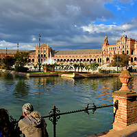 Expo Sevilla 1929 in Mar&iacute;a Luisa Park in Seville, Spain<br /> In 1893, Mar&iacute;a Luisa d&rsquo;Orleans, the wife of the Duke of Montpensier, donated the gardens of the San Telmo Palace to Seville. The 170 acres adjacent to the Guadalquivir River became an ideal location for the Ibero-American Exposition during the summer of 1929. Numerous pavilions were constructed to represent various countries. Master designer Jean-Claude Nicolas Forestier also orchestrated the creation of ponds and fountains among the trees and flower gardens. The resulting Parque de Mar&iacute;a Luisa was a spectacular setting for Expo Sevilla 1929. As evident from this view of Plaza de Espa&ntilde;a, Mar&iacute;a Luisa Park continues to be a must-see location when visiting Sevilla.