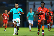 Forest Green Rovers Reuben Reid(26) and Wycombe Wanderers Anthony Stewart(5) chase for the ball during the 2nd round of the Carabao EFL Cup match between Wycombe Wanderers and Forest Green Rovers at Adams Park, High Wycombe, England on 28 August 2018.