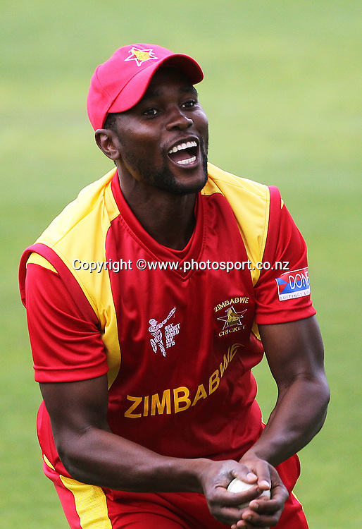 Elton Chigumbura captain of Zimbabwe warms up before the ICC Cricket World Cup warm up game between the Black Caps v Zimbabwe at Bert Sutcjliffe Oval, Lincoln, Christchurch. 9 February 2015 Photo: Joseph Johnson / www.photosport.co.nz