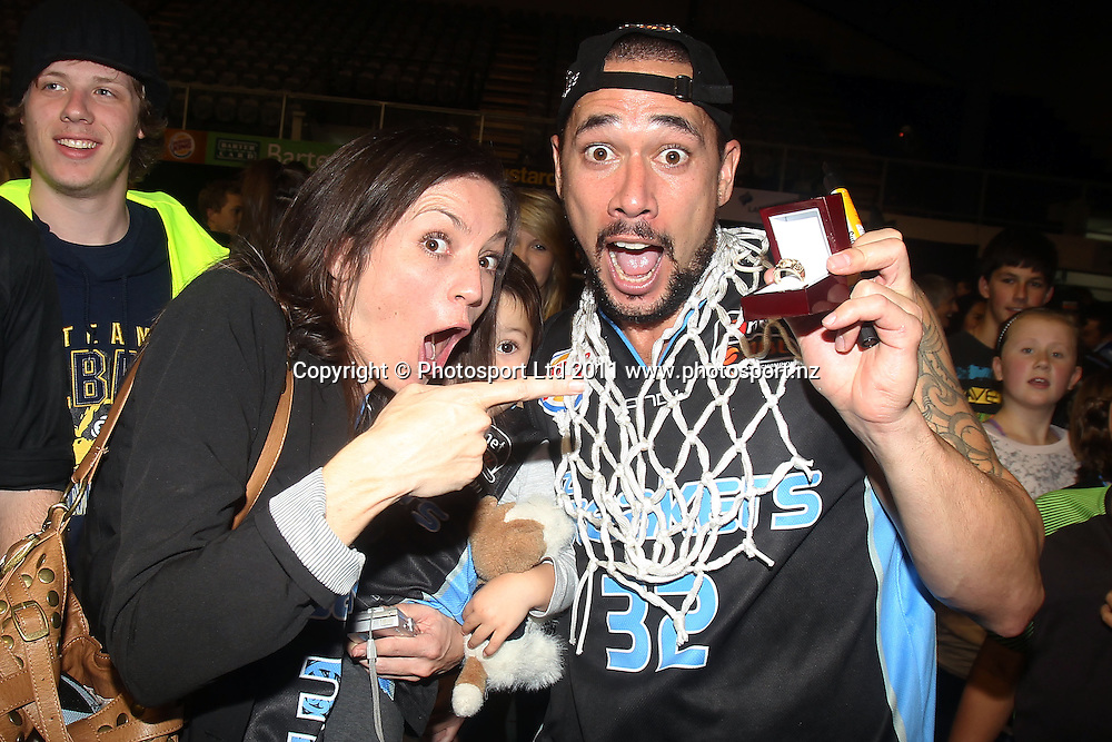Breakers' Paul Henare shows off his championship ring with his wife Lisa and daughter Kaia. iinet ANBL, Grand Final Game 3, New Zealand Breakers vs Cairns Taipans, North Shore Events Centre, Auckland, New Zealand. Friday 29th April 2011. Photo: Anthony Au-Yeung / photosport.co.nz