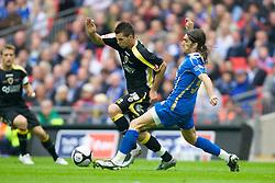 LONDON, ENGLAND - Saturday, May 17, 2008: Cardiff City's Joe Ledley and Portsmouth's Miguel Pedro Mendes during the FA Cup Final at Wembley Stadium. (Photo by David Rawcliffe/Propaganda)