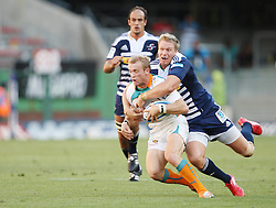 Sarel Pretorius is tackled by Jean de Villiers during the Super Rugby (Super 15) fixture between the DHL Stormers and the Cheetahs held at DHL Newlands Stadium in Cape Town, South Africa on 26 February 2011. Photo by Jacques Rossouw/SPORTZPICS