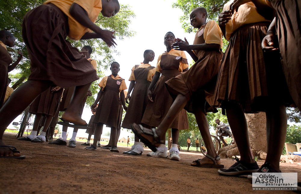 Girls play ampe, a traditional game based on jumping, clapping hands and rhythm, outside the Savelugu Junior Secondary School in Savelugu, Ghana on Tuesday June 5, 2007..