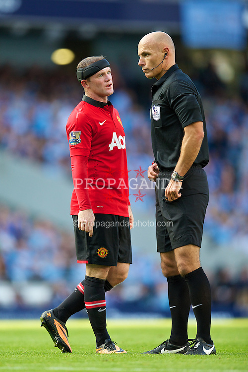MANCHESTER, ENGLAND - Sunday, September 22, 2013: Manchester United's Wayne Rooney and referee Howard Webb during the Premiership match against Manchester City at the City of Manchester Stadium. (Pic by David Rawcliffe/Propaganda)