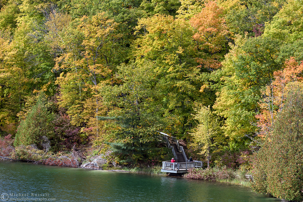 "A viewing platform along the Pink Lake Trail loop at Pink Lake (Lac Pink) in Gatineau Park, Québec, Canada.  Photographed during the ""Fall Rhapsody"" festival celbrating fall foliage colours in Gatineau Park."