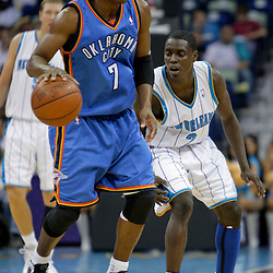 Oct 10, 2009; New Orleans, LA, USA;  New Orleans Hornets guard Darren Collison (2) defends Oklahoma City Thunder guard Kevin Ollie (7) during a preseason game at the New Orleans Arena. The Hornets defeated the Thunder 88-79. Mandatory Credit: Derick E. Hingle-US PRESSWIRE