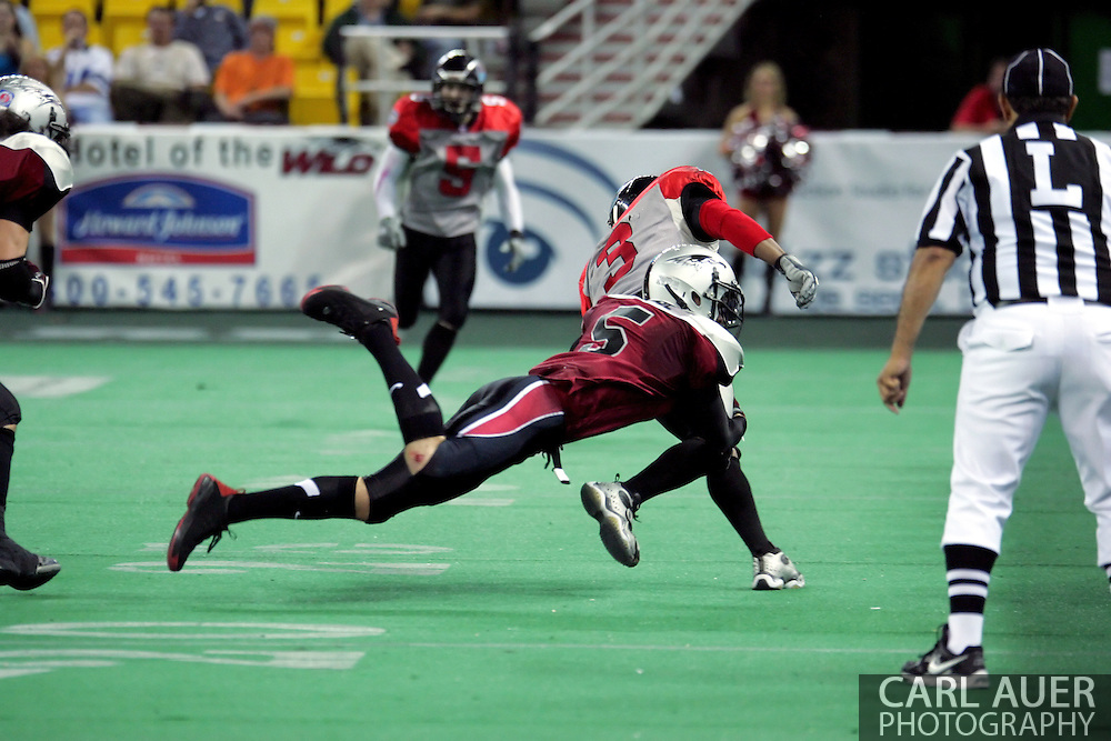 6-28-2007: Anchorage, AK - Alaska's Shawn Chase (5) goes for a tackle on CenTex's Olan Coleman (3) in the Alaska Wild 47 to 53 loss to the CenTex Barracudas at the Sullivan Arena...
