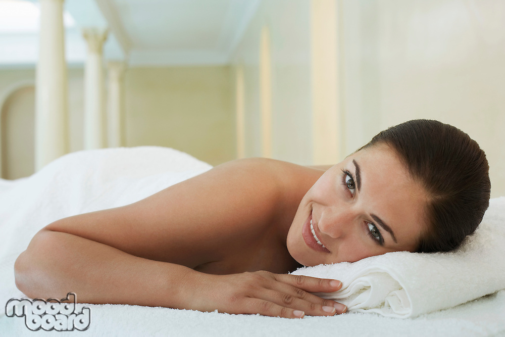 Young woman lying on massage table portrait
