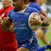 David Afamasaga sets a fierce tone for Manu Samoa in their upset victory over Canada 21-15 at the Canada 7's, Day 2, BC Place, Vancouver, British Columbia, Canada.  Photo by Barry Markowitz, 3/11/18, 3pm