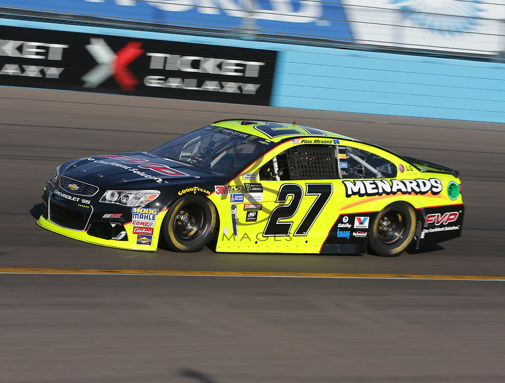 Paul Menard qualifies for Sunday's NASCAR Cup Series auto race on Friday, March 17, 2017, in Avondale, Ariz.  (AP Photo/Rick Scuteri)