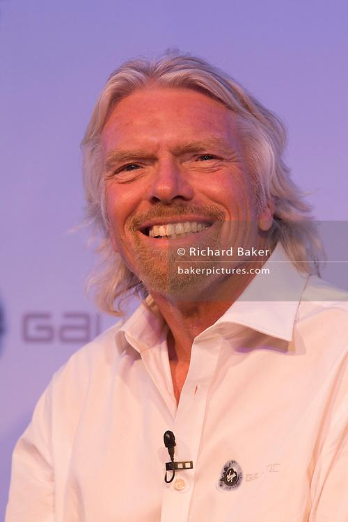 Sir Richard Branson speaks to audience during Virgin Galactic space tourism presentation at Farnborough Air Show.