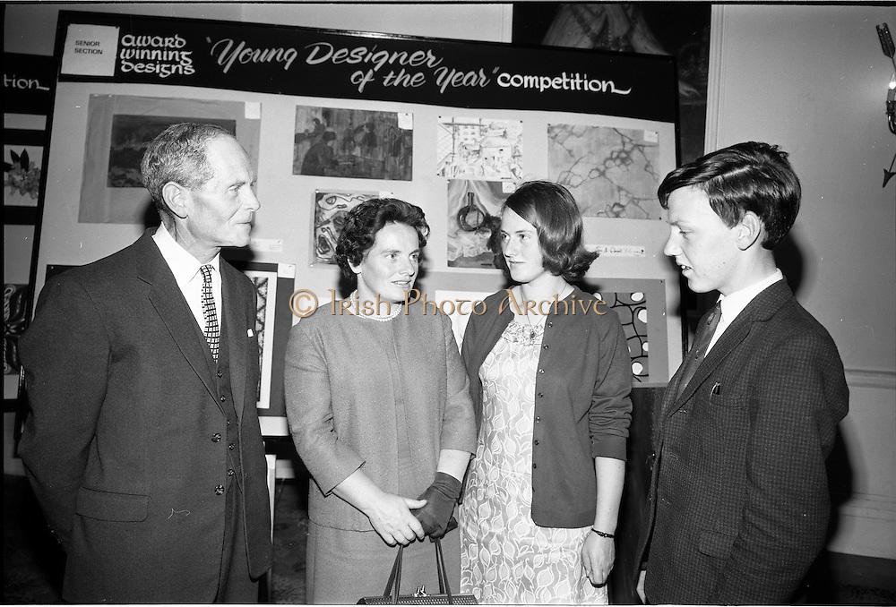 "28/06/1967<br /> 06/28/1967<br /> 28 June 1967<br /> Presentation of prizes at Navan Carpets ""Young Designer of the Year"" reception in the Royal Hibernian Hotel, Dublin. Image shows (l-r): Mr. B.V. Fox, Navan Carpets Ltd.; Mrs Dunne; Miss May Dunne and Mr. Jim Dunne, (prize-winner) Navan Co. Meath."