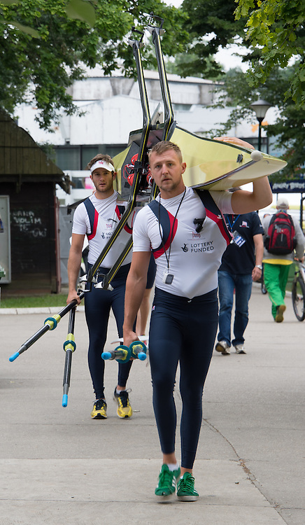 Belgrade, SERBIA, GBR M2X front John COLLINS and Jonny WALTON,carry their boat to the pontoon for their early morning paddle on finals day at the 2014 FISA European Rowing Championships. Lake Sava. <br /> <br /> <br /> 07:38:26  Sunday  01/06/2014<br /> <br /> [Mandatory Credit; Peter Spurrier/Intersport-images]