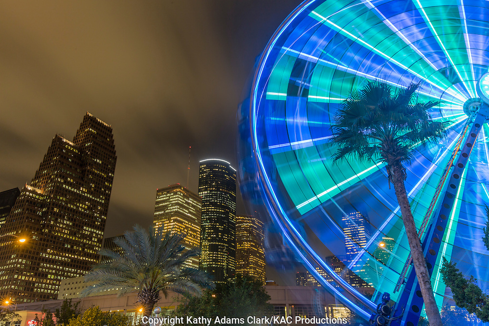 Ferris Wheel at the Downtown Aquarium restaurant with a night skyline of downtown Houston, Texas in the background.