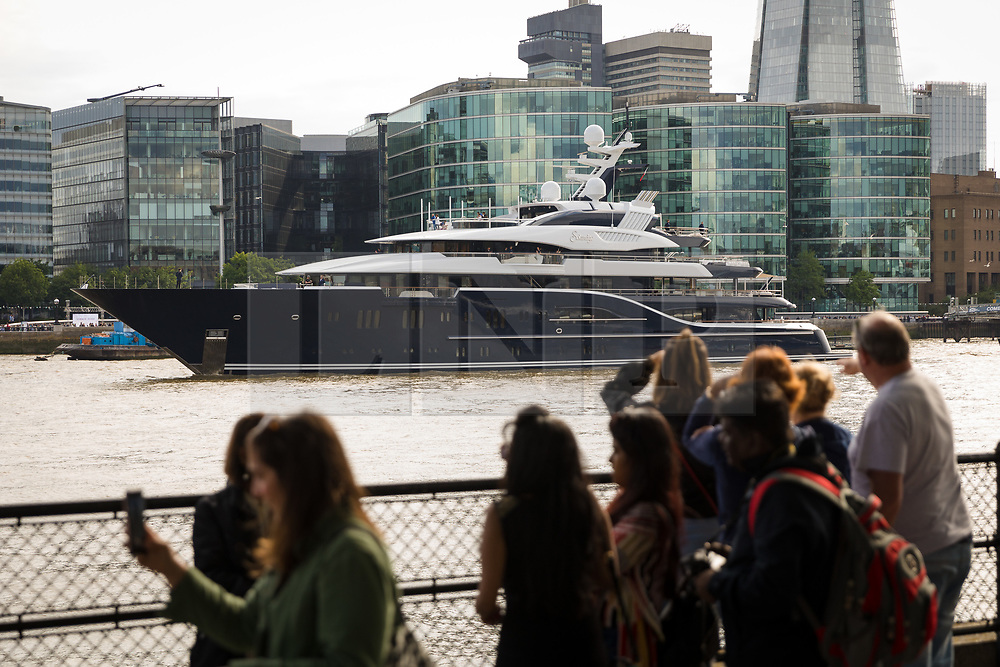 © Licensed to London News Pictures. 09/06/2019. London, UK.  People look at the luxury 279 feet long (85 metre) superyacht Solandge as it arrives in London on the River Thames this evening and is the first superyacht to visit the pool of London in the capital this year.  Superyacht Solandge is believed to have originally been built for the Russian billionaire Alexander Girda in 2013, superyacht Solandge is now rumoured to be owned by a Saudi Royal after being sold in 2017 for a reported EUR155m in the biggest yacht brokerage deal of 2017. Solandge is available for charter with rates starting from over EUR1m plus expenses per week and has numerous luxuries onboard including an outdoor cinema and nightclub with DJ deck, indoor and outdoor gyms, dive centre, tender garage, sauna, swimming pool, bar with Bechstein piano and has accommodation for 16 guests in eight elegant staterooms..  Photo credit: Vickie Flores/LNP
