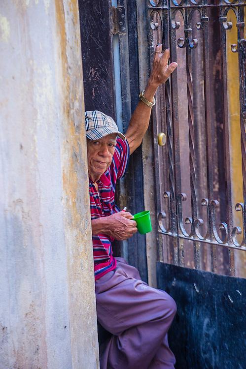 HAVANA, CUBA - JULY 18 : A portrait of a Cuban man in old Havana street on July 18 2016. The historic center of Havana is UNESCO World Heritage Site since 1982.