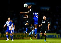 Victor Adeboyejo of Bristol Rovers is challenged by Gaetan Bong of Brighton & Hove Albion - Rogan/JMP - 27/08/2019 - FOOTBALL - Memorial Stadium - Bristol, England - Bristol Rovers v Brighton & Hove Albion - Carabao Cup.