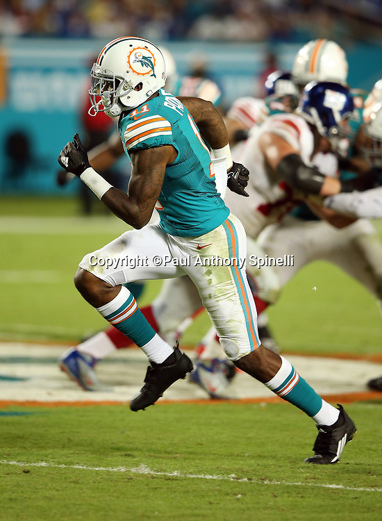 Miami Dolphins wide receiver DeVante Parker (11) goes out for a pass during the NFL week 14 regular season football game against the New York Giants on Monday, Dec. 14, 2015 in Miami Gardens, Fla. The Giants won the game 31-24. (©Paul Anthony Spinelli)