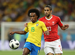 ROSTOV-ON-DON, June 17, 2018  Willian (L) of Brazil vies with Ricardo Rodriguez of Switzerland during a group E match between Brazil and Switzerland at the 2018 FIFA World Cup in Rostov-on-Don, Russia, June 17, 2018. The match ended in a 1-1 draw. (Credit Image: © Lu Jinbo/Xinhua via ZUMA Wire)