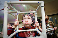 """JEROME A. POLLOS/Press..Robert Southern, 7, blows a bubble during Ramsey Elementary's """"All Science, All Day"""" event held Friday. The """"bubbleology"""" class was one of five science stations that tested the theory that any shaped bubble maker will result in a round bubble."""