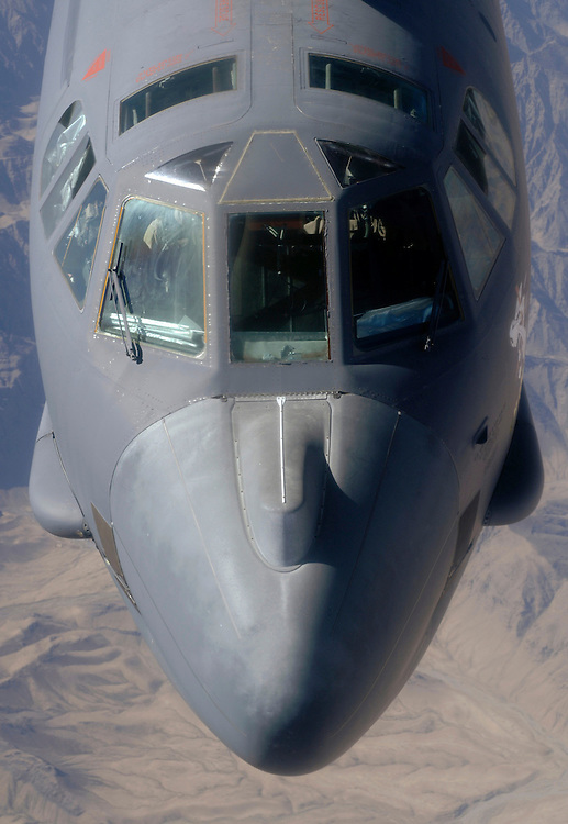"""Capt. """"Will"""" (right) and Major """"Tom"""" (left) pilot a lone B-52H Stratofortress bomber into a refueled position over Afghanistan, during a close air support mission for Coalition troops in contact with enemy forces. The  fuel will allow it to extend its time on station. To do this, the KC-135R/T Stratotanker ahead of it, will transfer fuel at about 16 gallons per second. They are deployed to the 20th Expetitionary Bomb Squadron, and from the 2nd Bomb Wing, Barksdale Air Force Base, La. (U.S. Air Force photo by Master Sgt. Lance Cheung)"""