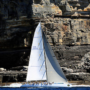 SYDNEY-DECEMBER 21: ASM Shockwave 5 sails past the Sydney Heads as it competes in The Rolex Trophy 2008 Rating series run by The Cruising Yacht Club of Australia on December 21, 2008 in Sydney, Australia. The racing series, conducted in the waters around Sydney, is a preliminary tournament to the Rolex Sydney Hobart Yacht race 2008 which will start of Boxing Day, December 26th. Over 100 yacht's are entered in this years race with spectators on the Sydney Harbour foreshore estimated to reach around 500,000 people. Photo Tim Clayton