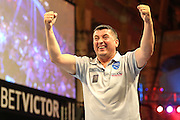 Mensur Suljovic celebrates beating Terry Jenkins during the First Round of the BetVictor World Matchplay Darts at the Empress Ballroom, Blackpool, United Kingdom on 19 July 2015. Photo by Shane Healey.