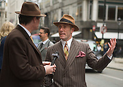 "Picture by Mark Larner. Picture shows Gustav Temple of The Chap Magazine. Chaps gathered outside Abercrombie & Fitch's London store to protest against the proposed opening of an A&F store on Savile Row, the centuries old home of bespoke tailoring. 23/04/2012..Press release from The Chap Magazine:-.""On Monday, 23rd April 2012 (St Georges Day) several hundred immaculately dressed Chaps and Chapettes will gather outside number 3, Savile Row, to protest in the strongest possible terms against the opening of a childrens clothes shop there by Abercrombie & Fitch.The Chap feels that this city is already overwhelmed with American-style chain stores selling overpriced T-shirts and hooded sporting garments for those who rarely do any sport. Savile Row has been the home of gentlemens bespoke tailoring for over 200 years, and the opening of this store would signal the end of this one little street being allowed to devote itself to a single trade.""."